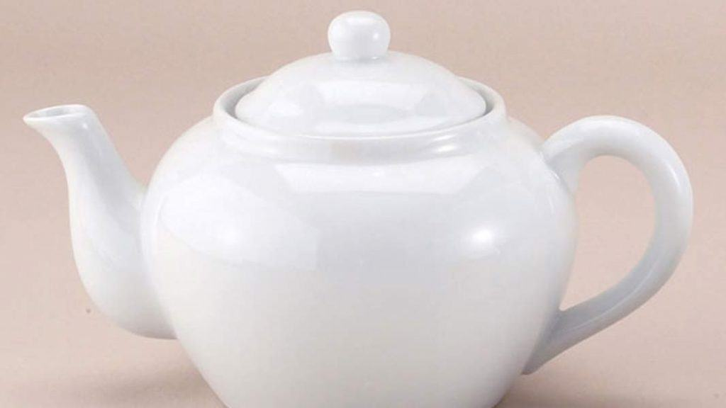 A plain white porcelain tea pot.